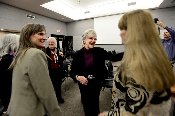 Josie Heath, a former County Commissioner greets current Commissioner Cindy Domenico as Elise Jones looks on at left at the Boulder County Courthouse.  Jones and Deb Gardner were sworn in on Tuesday January 8, 2013. <br /> Photo by Paul Aiken / The Daily Camera / January 8, 2013