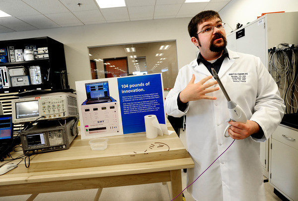 "Covidien employee Alex Waskiewicz explains the purpose of the some of the high tech equipment in the Hardware Laboratory at the company's open house Tuesday. Covidien, a medical supply and equipment company, unveiled to the public their new expanded facilities in Gunbarrel. <br /> Photo by Paul Aiken / The Camera /  For a video tour and more photos of the facility go to  <a href=""http://www.dailycamera.com"">http://www.dailycamera.com</a>"