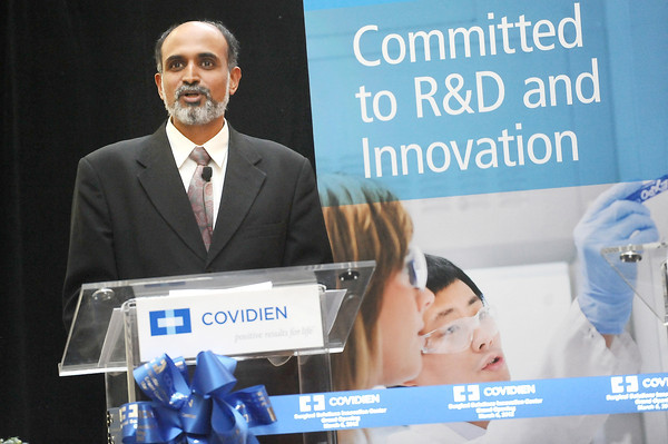 """Covidien Vice President of Research and Development Mani Prakash speaks at the company's open house Tuesday. Covidien, a medical supply and equipment company, unveiled to the public their new expanded facilities in Gunbarrel. Photo by Paul Aiken / The Camera /  For a video tour and more photos of the facility go to  <a href=""""http://www.dailycamera.com"""">http://www.dailycamera.com</a>"""