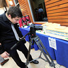 """Richard Fleming of Creative Coop videotapes a 3-D cake model of  Covidien's new facilities during an open house on Tuesday in Gunbarrel.<br /> Photo by Paul Aiken / The Camera /  For a video tour of the facility go to  <a href=""""http://www.dailycamera.com"""">http://www.dailycamera.com</a>"""
