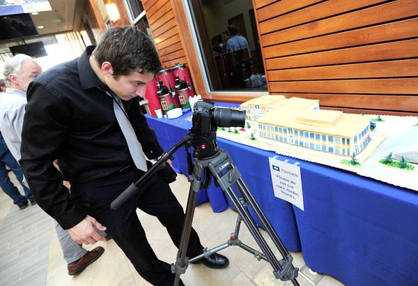 "Richard Fleming of Creative Coop videotapes a 3-D cake model of  Covidien's new facilities during an open house on Tuesday in Gunbarrel.<br /> Photo by Paul Aiken / The Camera /  For a video tour of the facility go to  <a href=""http://www.dailycamera.com"">http://www.dailycamera.com</a>"