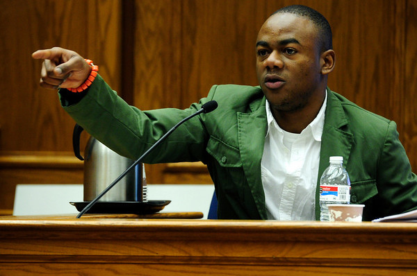COYTRIAL305.JPG COYTRIAL<br /> Olubiyi Ogundibe points to Joseph Coy while testifying in Coy's second degree assault and hate-crime trail on Tuesday.<br /> Photo by Marty Caivano/April 19, 2011
