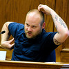 "COYTRIAL.JPG COYTRIAL<br /> Jared Kaszuba, a witness to the altercation between Joseph Coy and University of Colorado student Oluyibi Ogundipe, demonstrates the ""monkey"" gestures made by Coy and Zackery Harris.<br /> Photo by Marty Caivano/April 19, 2011"