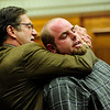 "COYTRIAL308.JPG COYTRIAL<br /> Joseph Coy, right, describes how he was put into a ""choke hold"" by Ahman Abdulkareem, as portrayed by Coy's attorney, Larry Martes, during Coy's trial on Tuesday.<br /> Photo by Marty Caivano/April 19, 2011"