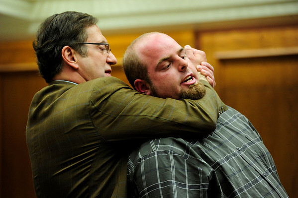 """COYTRIAL308.JPG COYTRIAL<br /> Joseph Coy, right, describes how he was put into a """"choke hold"""" by Ahman Abdulkareem, as portrayed by Coy's attorney, Larry Martes, during Coy's trial on Tuesday.<br /> Photo by Marty Caivano/April 19, 2011"""