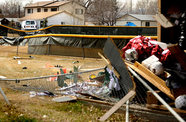 "CarCrash002.JPG The scene of a car accident on 96th Street in Louisville on Friday, March 25. The car crashed into a storage shed, through Miners Field and into a homeoners garage. For a video of the crash go to  <a href=""http://www.dailycamera.com"">http://www.dailycamera.com</a><br /> Jeremy Papasso/ Camera"