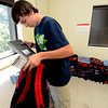 "Matthew Judson stuffs notebooks into a backpack as part of the Crayons to Calculators school supply drive in Boulder on Thursday July 19, 2011. For more photos and a video of the drive go to  <a href=""http://www.dailycamera.com"">http://www.dailycamera.com</a> <br /> Photo by Paul Aiken / The Camera"
