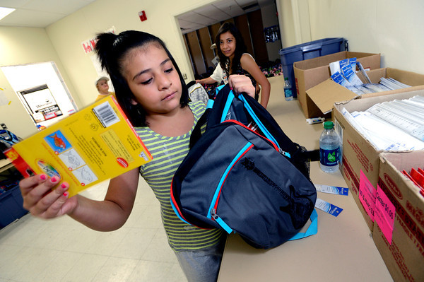 "Volunteer Itzel Duenas  stuffs school supplies into backpacks as part of the Crayons to Calculators drive in Boulder on Thursday July 19, 2011. For more photos and a video of the drive go to  <a href=""http://www.dailycamera.com"">http://www.dailycamera.com</a> <br /> Photo by Paul Aiken / The Camera"
