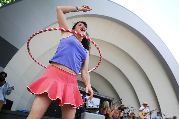 CreekfestKH_1.jpg Jody Evans, of Niwot, dances with a hula-hoop as local band Lucky Me performs on the ampitheater at the annual Boulder Creek Festival on Saturday, May 26, 2012. (Kira Horvath/Daily Camera)