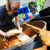 CreekfestKH_5.jpg Kelsey Doddridge scoops Kettle Korn into bags while working the All Time Favorites booth at the annual Boulder Creek Festival on Saturday, May 26, 2012. (Kira Horvath/Daily Camera)