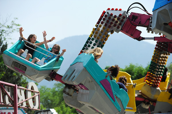 CreekfestKH_3.jpg Boulder's Ainsley Law, 9, left, and Amelia Anderson, 8, ride the Orbiter at the annual Boulder Creek Festival on Saturday, May 26, 2012. (Kira Horvath/Daily Camera)