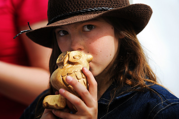 "CreekfestKH_6.jpg Berthoud's Quelenna Keller, 10, tries out a ""Toot Owl"" at the Musical Frogs.net booth at the annual Boulder Creek Festival on Saturday, May 26, 2012. (Kira Horvath/Daily Camera)"