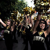 University of Colorado Goldrush Danceline member Sterling Loza, front, shows her school spirit during a performance at the Buff Stampede on Friday, Sept. 3, on the Pearl Street Mall.<br /> Jeremy Papasso/ Camera