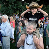 "Finn Griffith, 6, of Boulder, plugs his ears while on his father Chris Griffith's shoulders during a performance by the University of Colorado band at the Buff Stampede on Friday, Sept. 3, on the Pearl Street Mall.<br /> Jeremy Papasso/ Camera<br /> <br /> For a video of the Stampede and a photo gallery go to  <a href=""http://www.dailycamera.com"">http://www.dailycamera.com</a>"