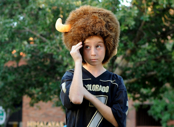 Billy Traxler, 11, of Broomfield, wears his buffalo hat and his No. 7 Cody Hawkins jersey during the Buff Stampede on Friday, Sept. 3, on the Pearl Street Mall.<br /> Jeremy Papasso/ Camera