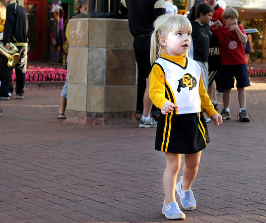 Sarah Chreist, 2, of Boulder, shows her team spirit with her cheerleading uniform during the Buff Stampede on Friday, Sept. 3, on the Pearl Street Mall.<br /> Jeremy Papasso/ Camera