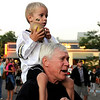 Dick Vossler, 65, and his grandson Sam Harding, 4, both of Longmont play with their mini Buff footballs during the Buff Stampede on Friday, Sept. 3, on the Pearl Street Mall.<br /> Jeremy Papasso/ Camera