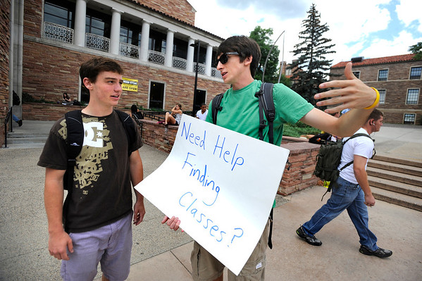Anton Baruh, left, gets some help finding a computer he can use from Bret Howarth, a volunteer from the The Annex college ministry on the first day of fall semester on the University of Colorado Boulder Campus.<br /> <br /> Photo by Paul Aiken / The Camera / August 22 2011