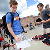 Garett Ross, left, prepares to sign up for an audition as In The Buff singing group president Tomas Reis continues to make a pitch to entice Ross outside the University Memorial Center on the first day of fall semester on the University of Colorado Boulder Campus.<br /> <br /> Photo by Paul Aiken / The Camera / August 22 2011