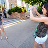 Anna.Kutateladze, right, takes a picture of her childhood friend Brittany Weiss outside the Cristol Chemistry building to memorialize their first college class  on the first day of fall semester on the University of Colorado Boulder Campus.<br /> Photo by Paul Aiken / The Camera / August 22 2011