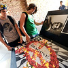 Roommates Greg Hamm, left, and Matthew Cole compare the qualities of posters on sale outside the University Memorial Center to decorate their rooms on the first day of fall semester on the University of Colorado Boulder Campus.<br /> <br /> Photo by Paul Aiken / The Camera / August 22 2011