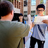 Mingjie Lu, at right, tries to make sense of his CU map as he gets directions from Paul Henry as Lui Jing looks on as students rush to their 8 am classes on the first day of fall semester on the University of Colorado Boulder Campus. <br /> Photo by Paul Aiken / The Camera / August 22 2011