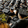 "University of Colorado graduate Lyndsi Magana, left, stands out of the crowd of graduates with her ""hire me"" sign on her graduation cap on Friday, Dec. 17, during the University of Colorado Fall Commencement Ceremony at the Coors Events Center on the CU campus in Boulder.<br />  For more photos and video of the ceremony go to  <a href=""http://www.dailycamera.com"">http://www.dailycamera.com</a><br /> Jeremy Papasso/Camera"