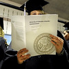 "University of Colorado graduate Rebeccah Kersteen reads her commencement catalog on Friday, Dec. 17, during the University of Colorado Fall Commencement Ceremony at the Coors Events Center on the CU campus in Boulder.<br /> For more photos and video of the ceremony go to  <a href=""http://www.dailycamera.com"">http://www.dailycamera.com</a><br /> Jeremy Papasso/Camera"