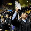 "University of Colorado graduate Alonzo Moreno tries to get the attention of his family on Friday, Dec. 17, during the University of Colorado Fall Commencement Ceremony at the Coors Events Center on the CU campus in Boulder.<br /> For more photos and video of the ceremony go to  <a href=""http://www.dailycamera.com"">http://www.dailycamera.com</a><br /> Jeremy Papasso/Camera"