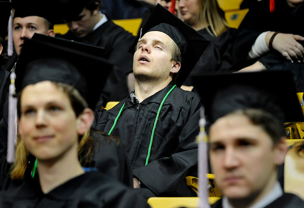 "University of Colorado graduate Zach Carter takes a nap on Friday, Dec. 17, during the University of Colorado Fall Commencement Ceremony at the Coors Events Center on the CU campus in Boulder.<br /> For more photos and video of the ceremony go to  <a href=""http://www.dailycamera.com"">http://www.dailycamera.com</a><br /> Jeremy Papasso/Camera"