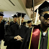 "University of Colorado graduate Myron Funchess, right, shows off his stylish sunglasses on Friday, Dec. 17, during the University of Colorado Fall Commencement Ceremony at the Coors Events Center on the CU campus in Boulder.<br /> For more photos and video of the ceremony go to  <a href=""http://www.dailycamera.com"">http://www.dailycamera.com</a><br /> Jeremy Papasso/Camera"