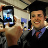 "University of Colorado graduate Jeremy Jonsen smiles while his mother Ida Jonsen takes a photograph with her cellular phone on Friday, Dec. 17, during the University of Colorado Fall Commencement Ceremony at the Coors Events Center on the CU campus in Boulder.<br /> For more photos and video of the ceremony go to  <a href=""http://www.dailycamera.com"">http://www.dailycamera.com</a><br /> Jeremy Papasso/Camera"