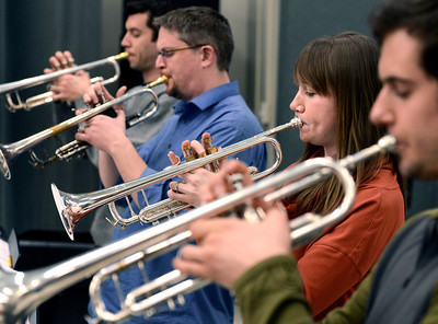 University of Colorado Jazz Band members Paul Sprowell, right, Christine Palmer, Dan Jonas and David Rajewski play their trumpets during a rehearsal on Tuesday, March 5, at the Imig Music building on the CU campus in Boulder. Jeremy Papasso/ Camera