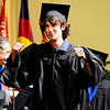 GRAD<br /> Zachary Jackson pumps his fists as he walks to collect his diploma during the University of Colorado's graduation ceremony for the School of Journalism and Mass Communication.<br /> Photo by Marty Caivano/May 5, 2011