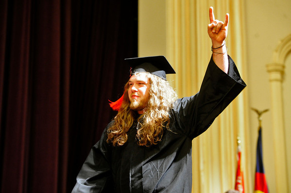 GRAD<br /> Taylor Iversen celebrates as he walks to collect his diploma during the University of Colorado's graduation ceremony for the School of Journalism and Mass Communication.<br /> Photo by Marty Caivano/May 5, 2011