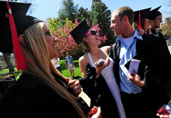 GRAD<br /> Left to right, Lauren Kuchta, Kelly Boyer and Mitch Herren congratulate each other before the University of Colorado's graduation ceremony for the School of Journalism and Mass Communication.<br /> Photo by Marty Caivano/May 5, 2011