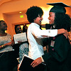 GRAD<br /> Jalesa Moore, right, gets a hug from Mileta Gebre-Michael after the University of Colorado's graduation ceremony for the School of Journalism and Mass Communication.<br /> Photo by Marty Caivano/May 5, 2011