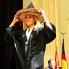 GRAD<br /> Emilie Talermo holds onto her sombrero as she walks to collect her diploma during the University of Colorado's graduation ceremony for the School of Journalism and Mass Communication.<br /> Photo by Marty Caivano/May 5, 2011