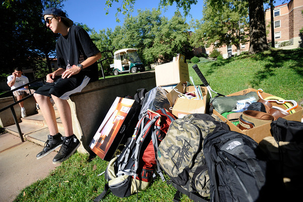 "Kyle Northrop, from Telluride, Colorado is in a waiting pattern as he waits to get his paperwork straightened out during freshman move in day on Tuesday August 16, 2011. FOR MORE PHOTOS FROM MOVE IN DAY GO TO  <a href=""http://WWW.DAILYCAMERA.COM"">http://WWW.DAILYCAMERA.COM</a> AND COLORADODAILY.COM<br /> Photo by Paul Aiken / The Camera / 8/ 16/ 11"