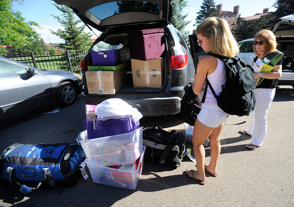 "Haily Smith from Los Angeles can't decide what to carry next as her mother Christine helps her during freshman move in day on Tuesday August 16, 2011. FOR MORE PHOTOS FROM MOVE IN DAY GO TO  <a href=""http://WWW.DAILYCAMERA.COM"">http://WWW.DAILYCAMERA.COM</a> AND COLORADODAILY.COM<br /> Photo by Paul Aiken / The Camera / 8/ 16/ 11"