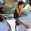 "Robert Cates from St. Louis, Missouri balances his load during freshman move in day on Tuesday August 16, 2011. FOR MORE PHOTOS FROM MOVE IN DAY GO TO  <a href=""http://WWW.DAILYCAMERA.COM"">http://WWW.DAILYCAMERA.COM</a> AND COLORADODAILY.COM<br /> Photo by Paul Aiken / The Camera / 8/ 16/ 11"