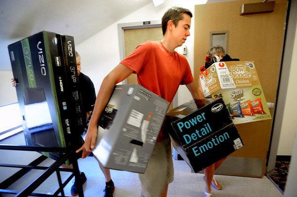 "Tom Joles, left and Pat Peterman, right, carry a heavy load to help their son Max Joes move into Hallet Hall during freshman move in day on Tuesday August 16, 2011. The family is from Albuquerque New Mexico. FOR MORE PHOTOS FROM MOVE IN DAY GO TO  <a href=""http://WWW.DAILYCAMERA.COM"">http://WWW.DAILYCAMERA.COM</a> AND COLORADODAILY.COM<br /> Photo by Paul Aiken / The Camera / 8/ 16/ 11"