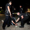 "University of Colorado police officer Emily Smyly, left, Sergeant Adam Trojanowski, middle, and officer Mike Deloncker, right, work together to handcuff Kevin McClellan, 18, of Boulder, after a foot chase during a patrol on Thursday, Sept. 6, on the CU campus in Boulder. McClellan was ticketed twice in one night on two seperate incidents. For more photos and video of the CU police in action go to  <a href=""http://www.dailycamera.com"">http://www.dailycamera.com</a><br /> Jeremy Papasso/ Camera"