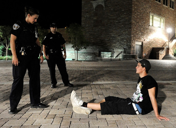 "University of Colorado police officer Emily Smyly, left, questions Kevin McClellan, 18, of Boulder, after a foot chase during a patrol on Thursday, Sept. 6, on the CU campus in Boulder. McClellan was ticketed twice in one night on two seperate incidents. For more photos and video of the CU police in action go to  <a href=""http://www.dailycamera.com"">http://www.dailycamera.com</a><br /> Jeremy Papasso/ Camera"