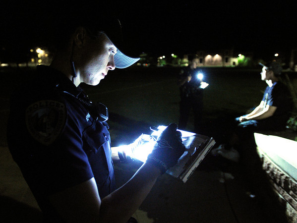 "University of Colorado police officer Amy Pratt, left, and officer Emily Smyly write tickets for possession of marijuana and minor in possession during a patrol on Thursday, Sept. 6, on the CU campus in Boulder. For more photos and video of the CU police in action go to  <a href=""http://www.dailycamera.com"">http://www.dailycamera.com</a><br /> Jeremy Papasso/ Camera"