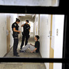 "University of Colorado police officer Emily Smyly, left, and officer Amy Pratt confront a student suspected of drinking in Libby Hall during a patrol on Thursday, Sept. 6, on the CU campus in Boulder. For more photos and video of the CU police in action go to  <a href=""http://www.dailycamera.com"">http://www.dailycamera.com</a><br /> Jeremy Papasso/ Camera"