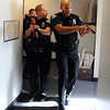 "Officer Daniel Diaz, right, leads Mike Deloncker and Kevin Marples down a hallway during a training exercise.<br /> New University of Colorado police were trained in an ""active harmer"" scenario, similar to a Virginia Tech shooting situation.<br /> For a video of the CU Police training exercise, go to  <a href=""http://www.dailycamera.com"">http://www.dailycamera.com</a>.<br /> December 28, 2011 / Cliff Grassmick"