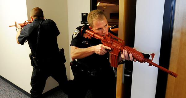 """Officers, Kevin Marples, left, and Mike Deloncker, participate in a training exercise on the CU campus on Wednesday.<br /> New University of Colorado police were trained in an """"active harmer"""" scenario, similar to a Virginia Tech shooting situation.<br /> For a video of the CU Police training exercise, go to  <a href=""""http://www.dailycamera.com"""">http://www.dailycamera.com</a>.<br /> December 28, 2011 / Cliff Grassmick"""