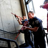 "Officers, Kevin Marples, left, and Mike Deloncker, participate in a training exercise, while instructor, Ken Pacheco, right, gives instruction.<br /> New University of Colorado police were trained in an ""active harmer"" scenario, similar to a Virginia Tech shooting situation.<br /> For a video and more photos  of the CU Police training exercise, go to  <a href=""http://www.dailycamera.com"">http://www.dailycamera.com</a>.<br /> December 28, 2011 / Cliff Grassmick"