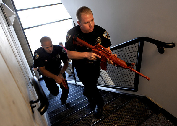 """Officers, Daniel Diaz, left, and Mike Deloncker, participate in an exercise.<br /> New University of Colorado police were trained in an """"active harmer"""" scenario, similar to a Virginia Tech shooting situation.<br /> For a video of the CU Police training exercise, go to  <a href=""""http://www.dailycamera.com"""">http://www.dailycamera.com</a>.<br /> December 28, 2011 / Cliff Grassmick"""